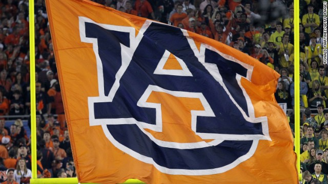 A large banner bearing the Auburn logo is hoisted after the Tigers won the BCS national championship in January 2010.