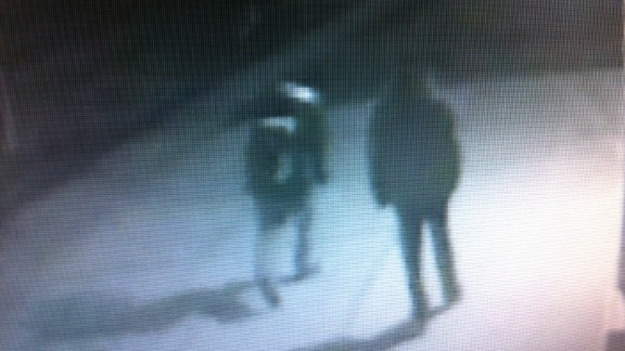 Authorities are looking for two men that surveillance video appears to show walking off with a firearm thrown from Lohr