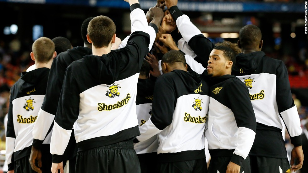 Wichita State players huddle before the tip-off against Louisville.
