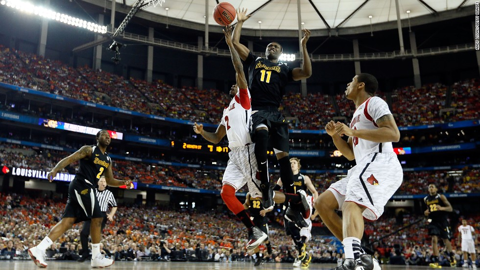 Russ Smith of Louisville drives for a shot against Cleanthony Early (11), of Wichita State.