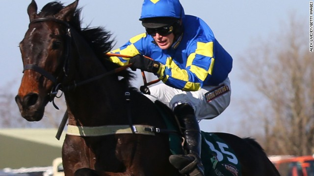 Ryan Mania riding Auroras Encore clears the last to win the Grand National steeplechase at Aintree Racecourse on Saturday.