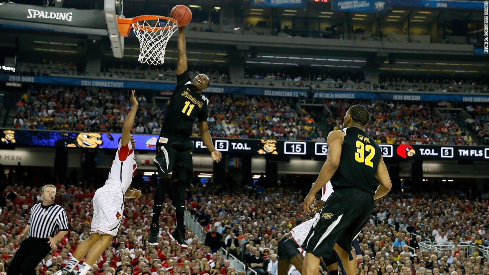 Cleanthony Early of Wichita State dunks against Louisville.