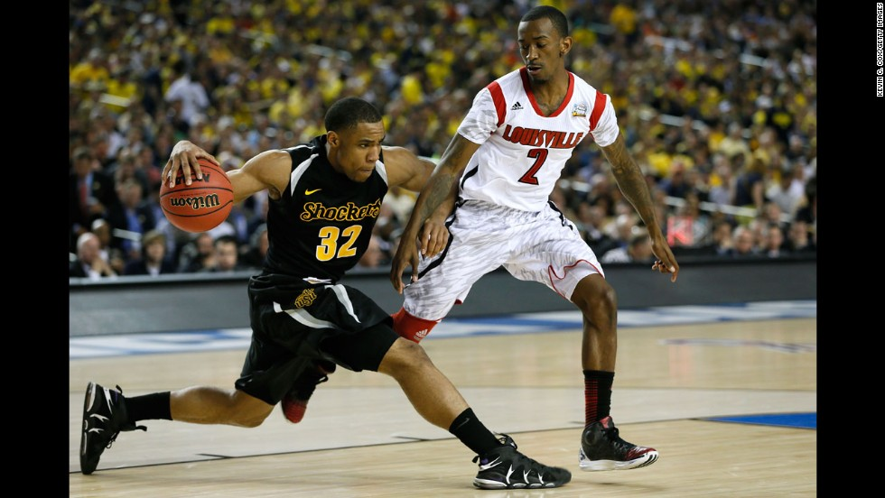 Tekele Cotton of Wichita State drives the ball up court in the second half against Russ Smith of Louisville.