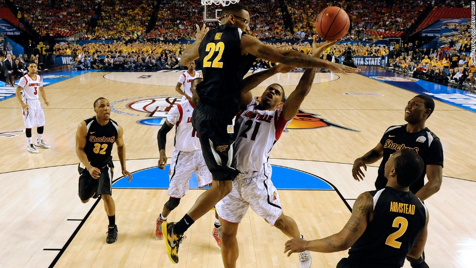 Chane Behanan of Louisville, center right, attempts a shot against Carl Hall of Wichita State.