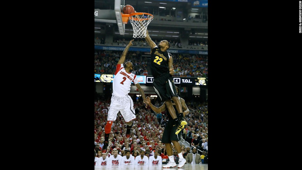 Carl Hall of Wichita State blocks a shot attempt by Russ Smith of Louisville.