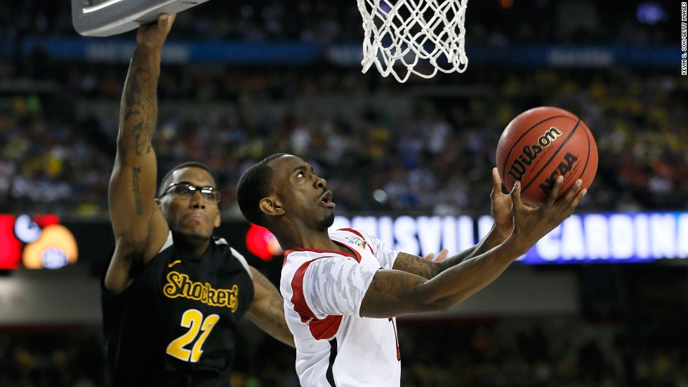 Russ Smith of the Louisville Cardinals drives for a shot in the second half against the Wichita State Shockers.