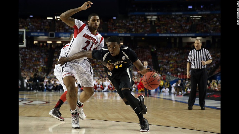 Cleanthony Early of Wichita State drives against Chane Behanan of Louisville.