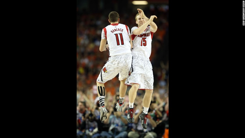 Luke Hancock, left, and Tim Henderson, right, of Louisville celebrate in the second half.