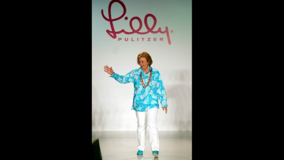 """Designer Lilly Pulitzer died on Sunday, April 7, at the age of 81, according to her company's Facebook page. The Palm Beach socialite was known for making sleeveless dresses from bright floral prints that became known as the """"Lilly"""" design. Pictured, Pulitzer waves to the audience after the showing of her Spring 2003 collection."""