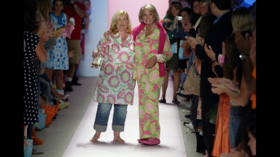 Pulitzer, right, walks down the runway at the spring 2005 show.