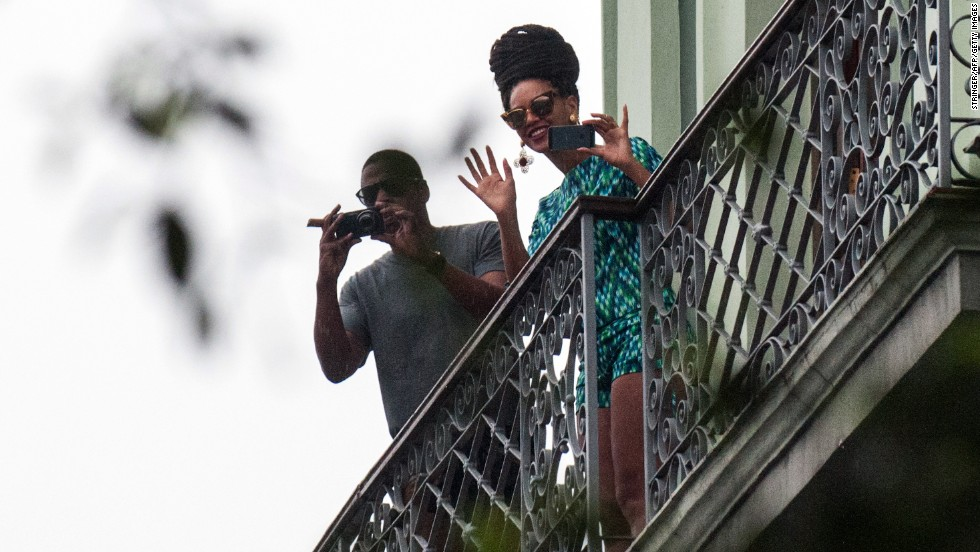 "Celebrities Beyonce and Jay-Z look out at the crowd from their balcony at the Saratoga Hotel in Havana on Friday, April 5. The couple were photographed in Havana last week, apparently celebrating their fifth wedding anniversary on the island. <a href=""http://politicalticker.blogs.cnn.com/2013/04/06/lawmakers-ask-why-beyonce-and-jay-z-went-to-cuba/"">Two Republican lawmakers</a> are asking a government agency to look into a recent trip to Cuba by the couple, suggesting they violated restrictions on travel to the communist island."