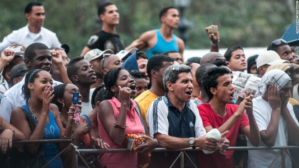 Cubans cheer as they wait to see Beyonce in front of the Saratoga Hotel in Havana on Friday. For decades, the U.S. government prohibited tourism to Cuba. In 2012, the Obama administration lifted some of the restrictions on travel to the country. Rules require a strict  itinerary for vacationers.
