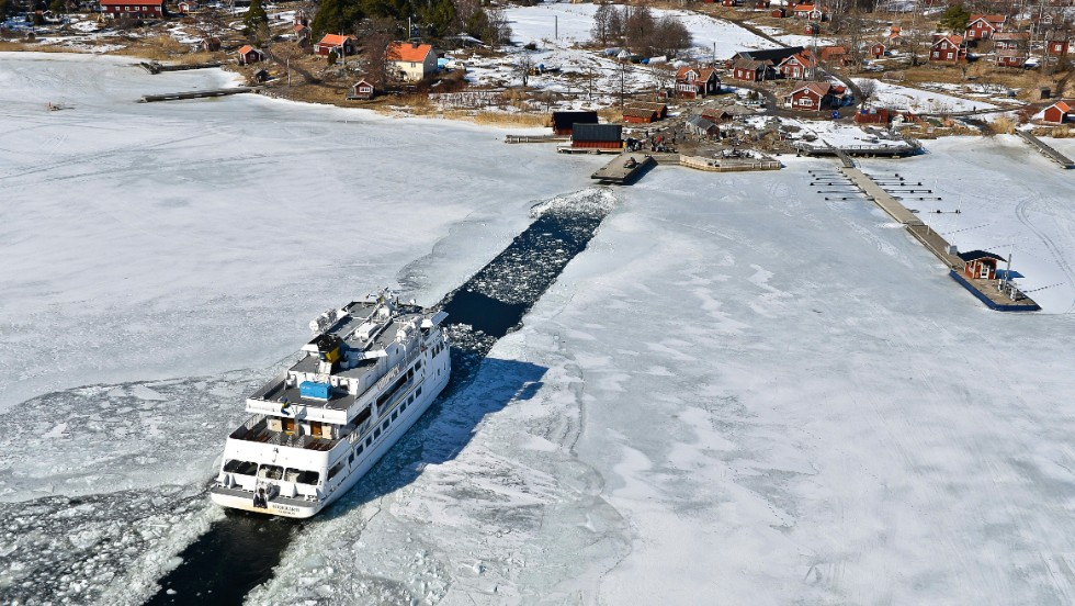 A passenger ship makes its way through a channel to the Swedish island of Husaro on Friday, April 5.