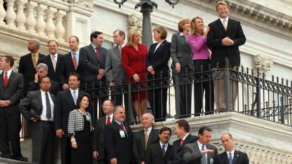 Newly elected representatives, including Giffords at second from top right, prepare for the freshman class picture for the 110th Congress on the House steps on November 14, 2006. She represented Arizona