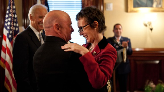 Kelly hugs his wife after receiving the Legion of Merit from Vice President Joe Biden during a retirement ceremony in Washington on October 6, 2011.