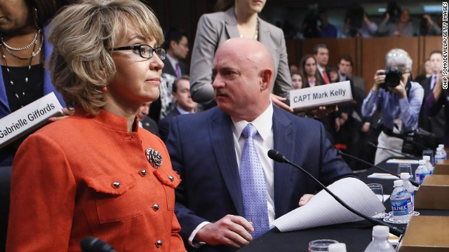 Giffords and Kelly arrive for a Senate Judiciary Committee hearing about gun control on Capitol Hill in Washington on January 30, 2013. The former congresswoman delivered an opening statment to the committee, which met for the first time since the mass shooting at a Sandy Hook Elementary School in Newtown, Connecticut.