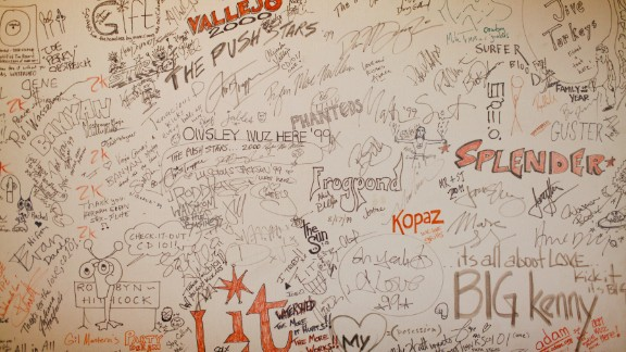 Bands that perform at the station leave their mark on walls around the Big Room.