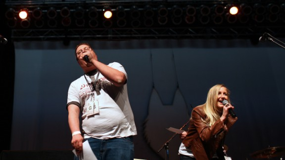 DJ Nate and Krista Kae introduce local band Post Coma Network, the opening act for the Second Dose of the CD102.5 Day concert series on April 6 at the Lifestyle Communities Pavilion in Columbus. The station supports local artists.