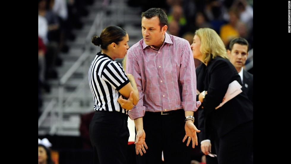 Head coach Jeff Walz of Louisville speaks to an official after a play against UCONN on April 9.