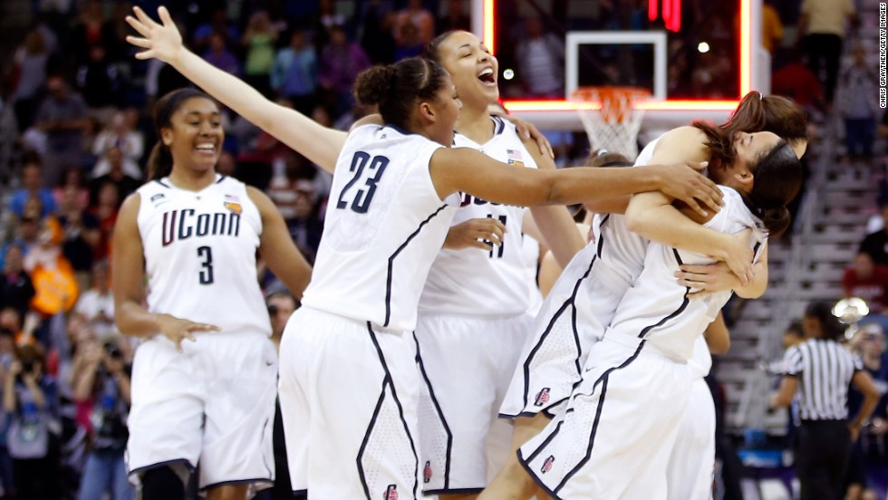 Connecticut Huskies players celebrate after defeating the Louisville Cardinals 93-60 during the NCAA Women's Championship at New Orleans Arena on April 9.