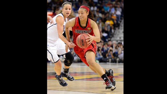 Antonita Slaughter of the Louisville Cardinals handles the ball against Caroline Doty of the Connecticut Huskies on April 9.