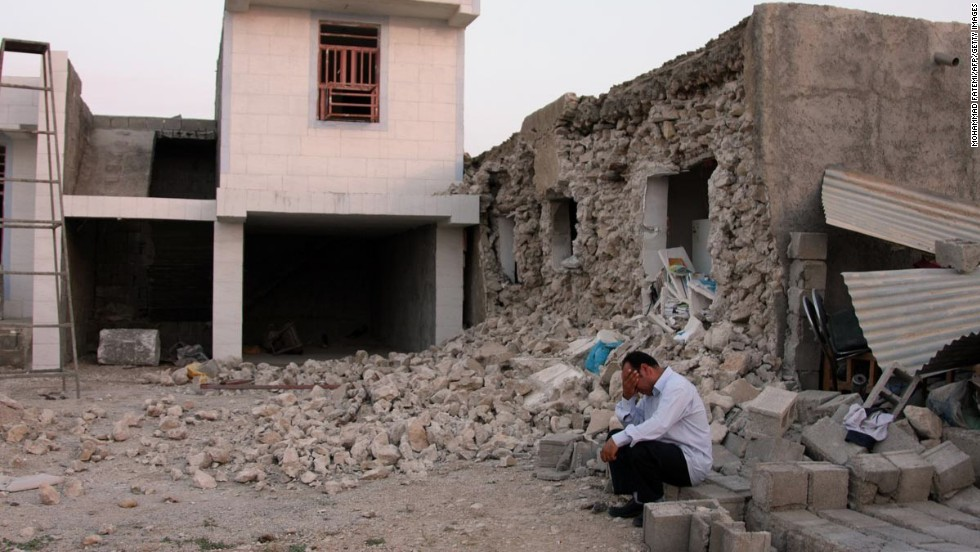 The quake leaves a man devastated after destroying his house in Shanbeh on April 9.