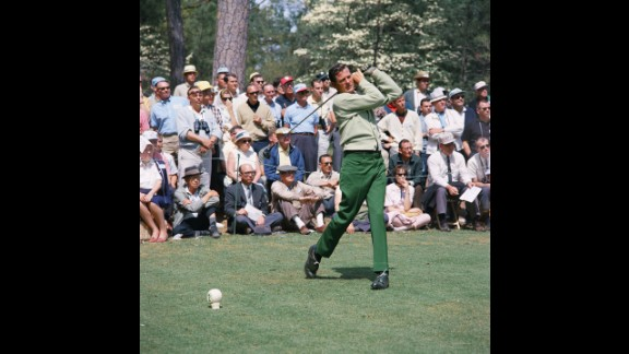 """Doug Sanders, one of golf's earliest flamboyant dressers, tees off on the second hole during the 1966 Masters. His knack for lively fabrics earned him the nickname """"Peacock of the Fairways."""""""