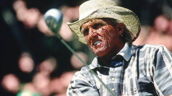 """Greg Norman's straw hat, seen here during the 1996 Masters, became part of his signature look. The Aussie earned his nickname """"The Shark"""" because of his aggressive play and """"great white"""" (read: blond) hair. Though he never won the Masters -- he came in second three times -- his clothing line, the Greg Norman Collection, is one of the leading golf-inspired sportswear lines. Its logo? A shark, of course."""
