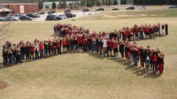 """The END IT movement asked people to raise awareness about modern-day slavery on April 9 by drawing a red X on their hands. """"END IT is starting the conversation around the globe,"""" says Ken Sirmans, the director of student life at Loganville Christian Academy."""
