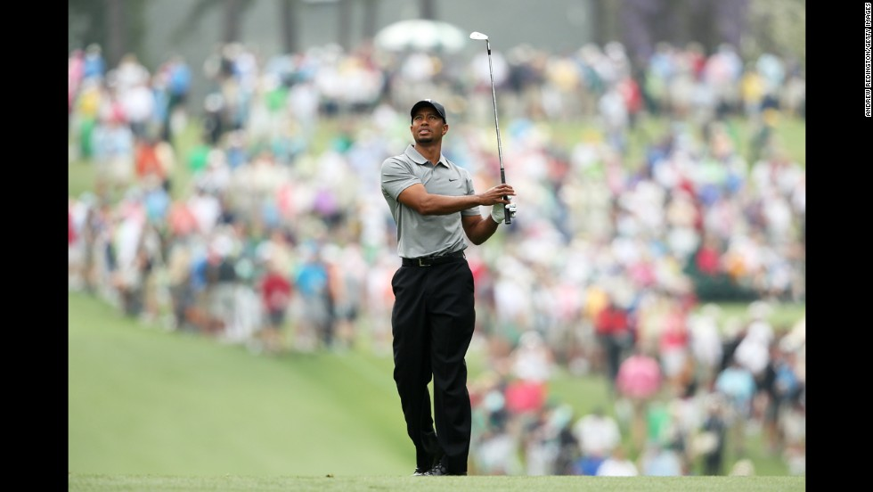 Tiger Woods hits a shot on the first hole.
