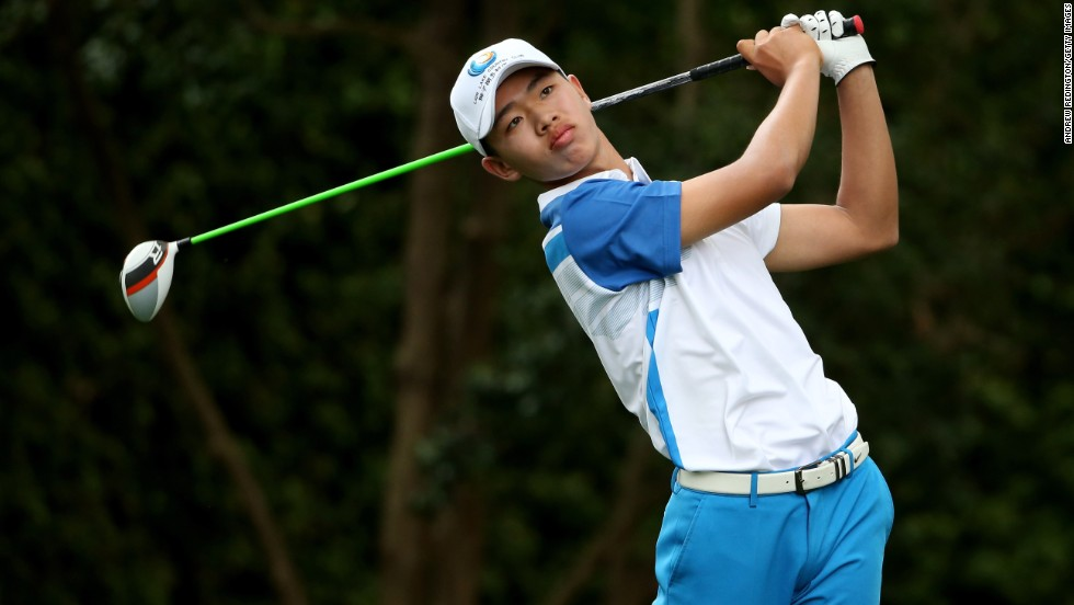 Tianlang Guan of China tees off on the second hole during the first round of the 2013 Masters Tournament at Augusta National Golf Club on Thursday, April 11 in Augusta, Georgia. Guan is the youngest competitor -- at the age of 14 years and five months -- in the 80 years of the tournament, beating the previous record held by then 16-year-old Matteo Manassero.