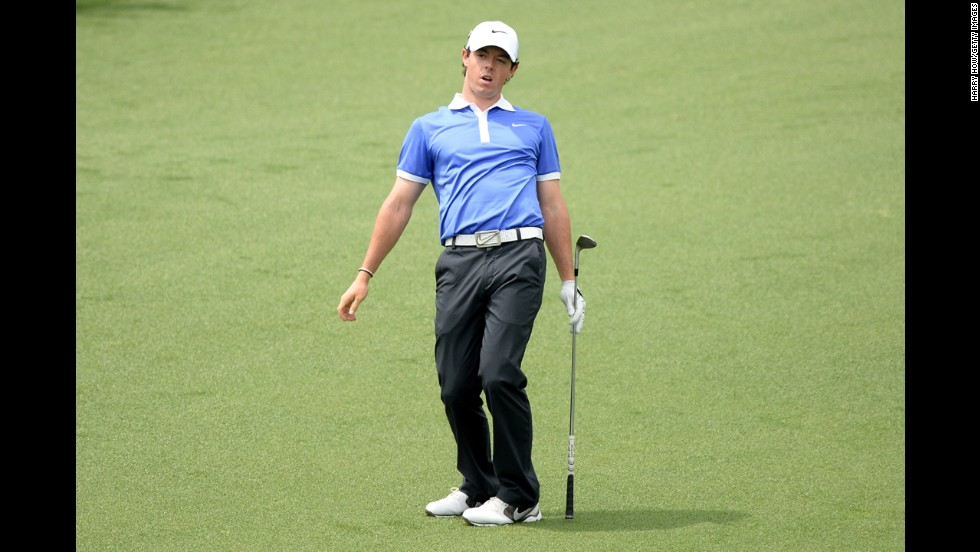 Rory McIlroy of Northern Ireland reacts to a missed chip for birdie on the second hole.