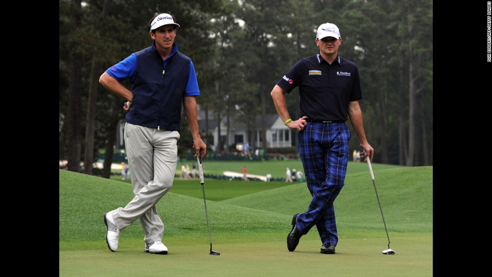 Gonzalo Fernandez-Castano of Spain and Paul Lawrie of Scotland during the second round on April 12.