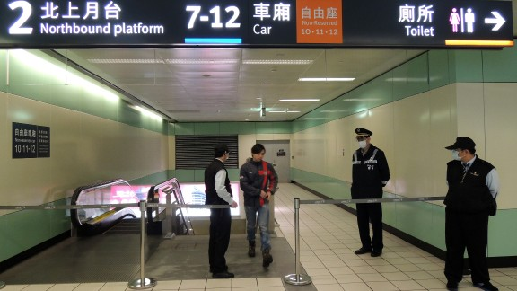 A passenger walks past the closed off area at Taoyuan High Speed Rail Station on April 12, 2013 after two suspected explosives and triggering devices found on the train.