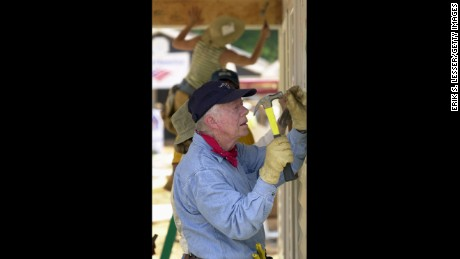 LAGRANGE, GA - JUNE 10: Former U.S. President Jimmy Carter attaches siding to the front of a Habitat for Humanity home being built June 10, 2003 in LaGrange, Georgia. More than 90 homes are being built in LaGrange; Valdosta, Georgia; and Anniston, Alabama by volunteers as part of Habitat for Humanity International's Jimmy Carter Work Project 2003. (Photo by Erik S. Lesser/Getty Images)