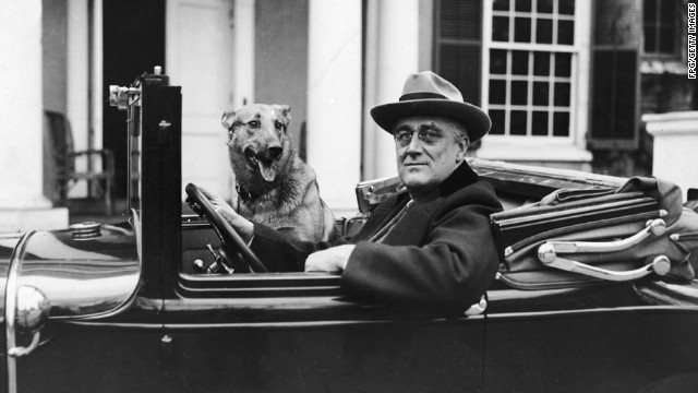 Portrait of American President Franklin Delano Roosevelt (1882 - 1945) as he sits behind the wheel of his car outside of his home in Hyde Park, New York, mid 1930s. (Photo by FPG/Getty Images)