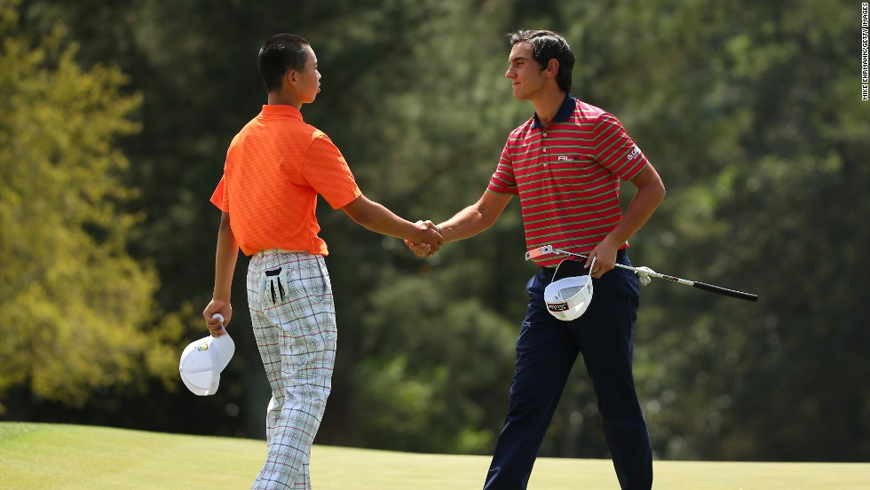 "Guan Tianlang of China shakes hands with Matteo Manassero of Italy after the second round of the 2013 Masters Tournament at Augusta National Golf Club on Friday, April 12, in Augusta, Georgia. Click through to see all the shots from the second day and <a href=""http://www.cnn.com/2013/04/11/golf/gallery/masters-round-one/index.html"" target=""_blank"">look back at the first round</a>."