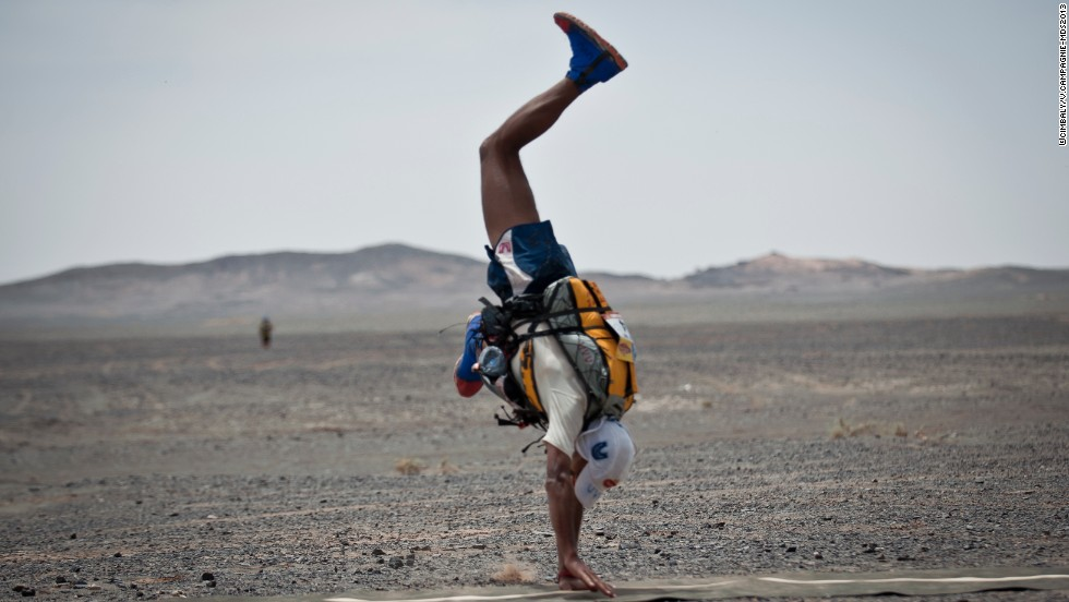 Moroccan Mohamad Ahansal crosses the line with a cartwheel to be crowned winner of this year's Marathon des Sables (MDS).