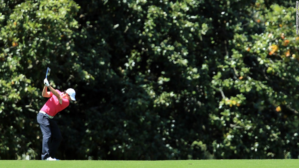 Rory McIlroy of Northern Ireland hits his second shot on the first hole.