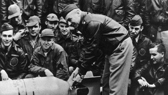 """Lt. Col. James Doolittle leans over a bomb on the USS Hornet deck just before his """"Raiders"""" began the bombing raid on Tokyo."""