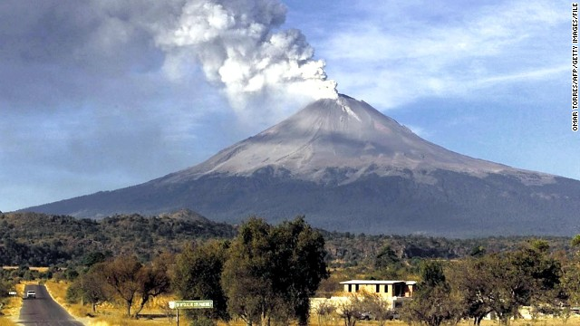 Smoke billows from the Popocatepetl volcano as it emits ash and steam 19 December, 2000 near the town of Papaxtla, Mexico. Mexican authorities have created a 10 km (six mile) restricted area around the volcano and have evacuated thousands of people from towns surrounding the base of Popocatepetl.