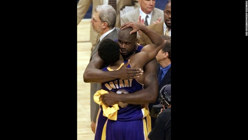 Lakers player Shaquille O'Neal, right, hugs teammate Bryant on June 14, 2000, after the Lakers beat the Indiana Pacers in game four of the NBA Finals at Conseco Fieldhouse in Indianapolis. The Lakers won the game 120-118 to take a 3-1 lead in the best-of-seven game series.