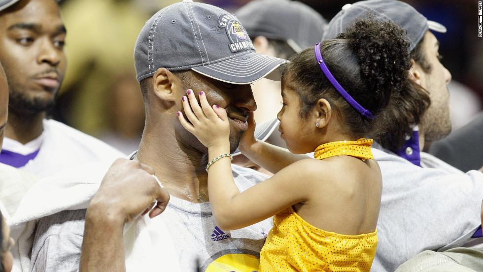 Bryant holds his daughter, Gianna, after the Lakers defeated the Orlando Magic in the NBA Finals on June 14, 2009.