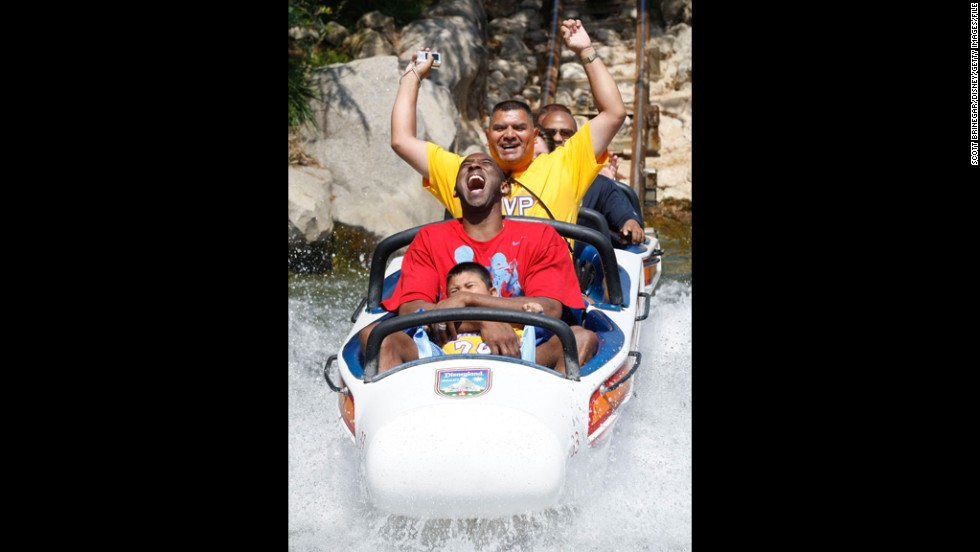 Bryant rides the Matterhorn Bobsleds with Jonathan Guerrero, 4, and his father, David Guerrero of Pomona, California, at Disneyland on June 18, 2009, in Anaheim, California. The Guerreros were among thousands of Lakers fans who turned out for a special Disneyland parade honoring the Lakers' 15th World Championship.