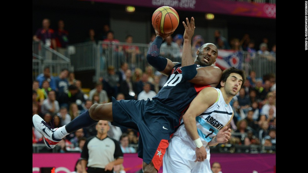 Bryant vies with Argentinian forward Leonardo Gutierrez during the USA men's basketball preliminary round match at the London Olympic Games on August 6, 2012.
