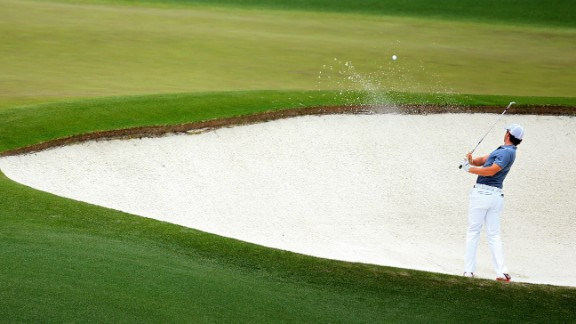 Rory McIlroy of Northern Ireland hits his second shot on the fourth hole.
