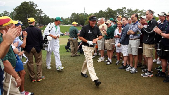 Phil Mickelson of the U.S. walks past the gallery as spectators clap during the final round.