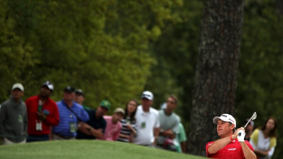 Lee Westwood of England hits a shot on the first hole.