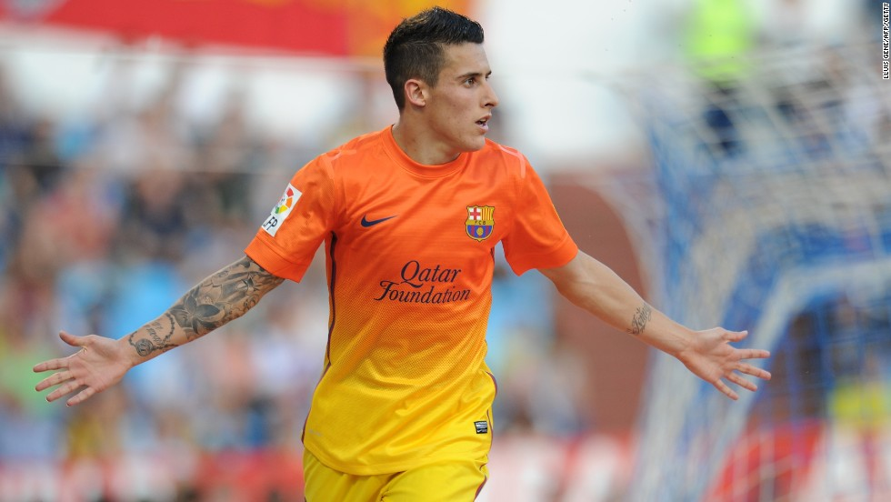 Cristian Tello scored twice as Barcelona, playing without talisman Lionel Messi, eased to a 3-0 win at Real Zaragoza to keep its title bid on track.