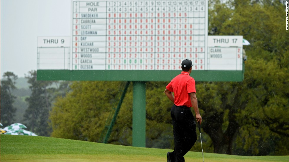 Tiger Woods of the U.S. stands on the 18th green.